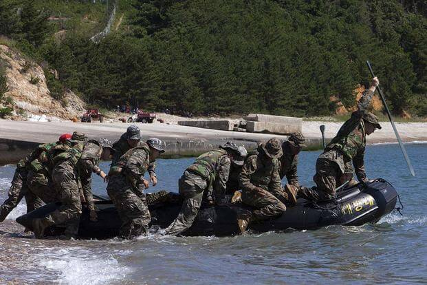 U.S. and Republic of Korea Marines launch an inflatable boat off the coast of Baengnyeongdo, Republic of Korea, during Korean Marine Exchange Program 15-13, Sept. 7, 2015. Photo By: Lance Cpl. Steven Tran