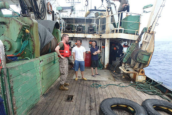 A USCGC Kukui (WLB 203) boarding team, with a shiprider from the Republic of the Marshall Islands, conducts an enforcement boarding of the fishing vessel Lomato in the Pacific Ocean Aug. 29, 2015. (U.S. Coast Guard photo)