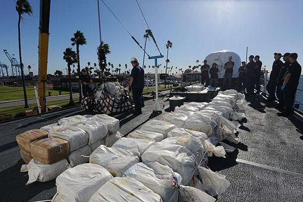 Crew members aboard Coast Guard Cutter Midgett offload an estimated 2,400 pounds of marijuana Nov. 16, 2015. (U.S. Coast Guard/PO1 Sondra-Kay Kneen)