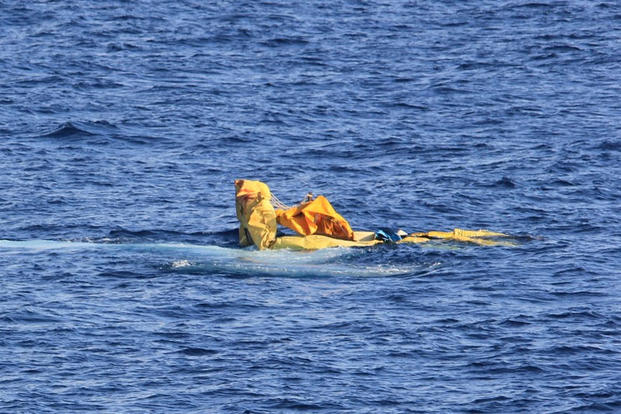 A Cuban migrant raft sinks off the coast of Florida, Dec. 31, 2015. The migrants safely embarked a Coast Guard smallboat and were repatriated to Cuba. (U.S. Coast Guard photo.)