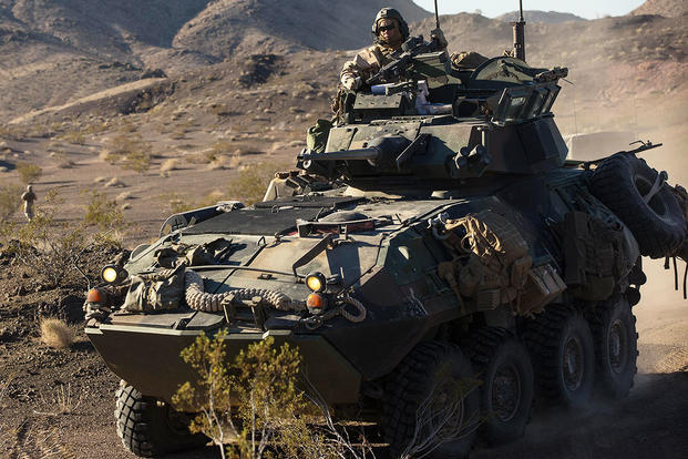 A light armored vehicle with Company B, 3rd Light Armored Reconnaissance Battalion, maneuvers into a security position during a Marine Corps Combat Readiness Evaluation Exercise at Twentynine Palms. (U.S. Marine Corps/Lance Cpl. Levi Schultz)