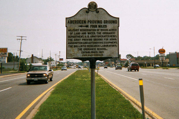 Historic plaque about the Aberdeen Proving Ground on the median of U.S. Route 40 in Aberdeen, Maryland. (Photo: Wikimedia Commons by DanTD)