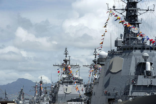 Ships moored at Joint Base Pearl Harbor-Hickam, Hawaii, display maritime signal pennants and flags from their masts during Rim of the Pacific 2016 on July 4, 2016. Jeff Troutman/U.S. Navy