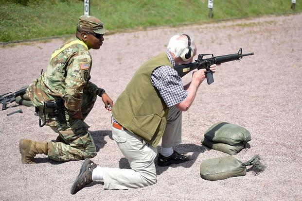 Staff Sgt. Lionell Red Cloud supports a German competitor during the annual German-American Marksmanship Competition at Oberdachstetten Training Area near Ansbach, Germany, July 8, 2016. (U.S. Army/Stephen Baack)