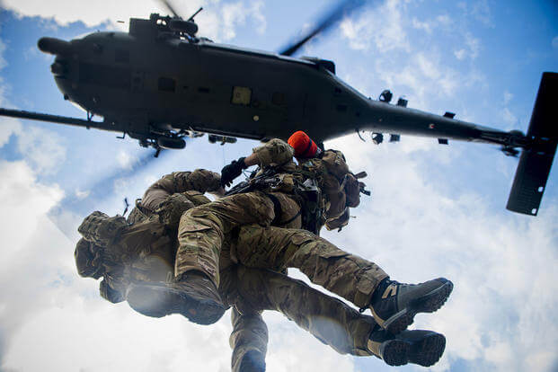 Second Lt. Kendrick Passey and Staff Sgt. Craig Patterson, with 38th Rescue Squadron, get hoisted to an HH-60 Pave Hawk during training at Avon Park Air Force Range, Fla., in 2012.Staff Sgt. Jamal D. Sutter/Air Force