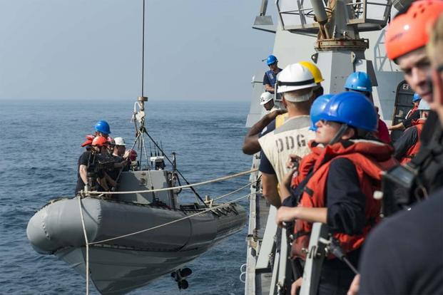 Sailors assigned to the guided-missile destroyer USS Nitze (DDG 94) render assistance to a distressed Iranian vessel. (U.S. Navy photo/Petty Officer 3rd Class Casey J. Hopkins)