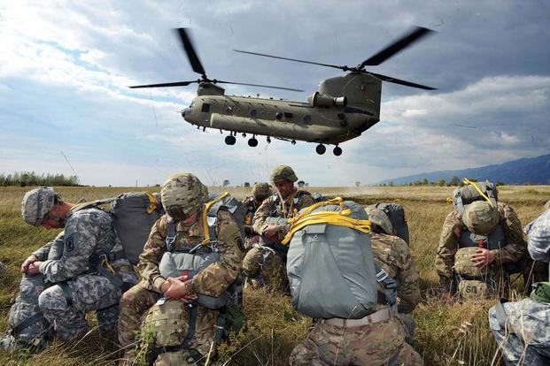 Paratroopers from 173rd Brigade Support Battalion, 173rd Airborne Brigade, prepare to board a 12th Combat Aviation Brigade CH-47 Chinook helicopter for an airborne operation, at Juliet Drop Zone, in Pordenone, Italy. (Photo Credit: Paolo Bovo)