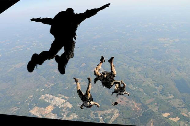 FILE PHOTO: Navy SEALs jump from the ramp of a C-17 Globemaster III April 15, 2010, over Fort Pickett Maneuver Training Center, Va. (U. S. Air Force/Staff Sgt. Brian Ferguson)