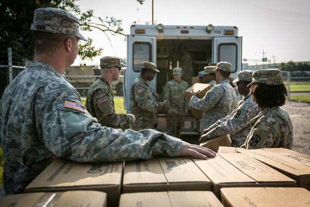Soldiers from the 36th Engineer Brigade from Fort Hood load boxes of Meals-Ready-to-Eat into an Red Cross Emergency Response Vehicle in support of relief operations for Hurricane Harvey victims in Beaumont, Texas, Sep. 1. (U.S. Army/ Spc. Liem Huynh)