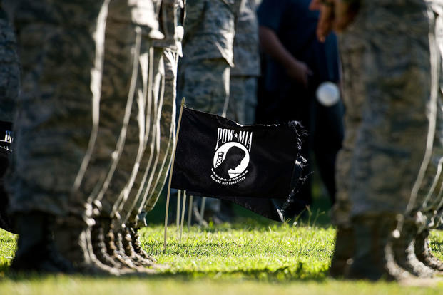 Twenty POW/MIA flags wave in a steady breeze during a retreat ceremony commemorating National POW/MIA Recognition Day Sept. 16, 2016, on Dover Air Force Base, Del. (U.S. Air Force photo/Roland Balik)