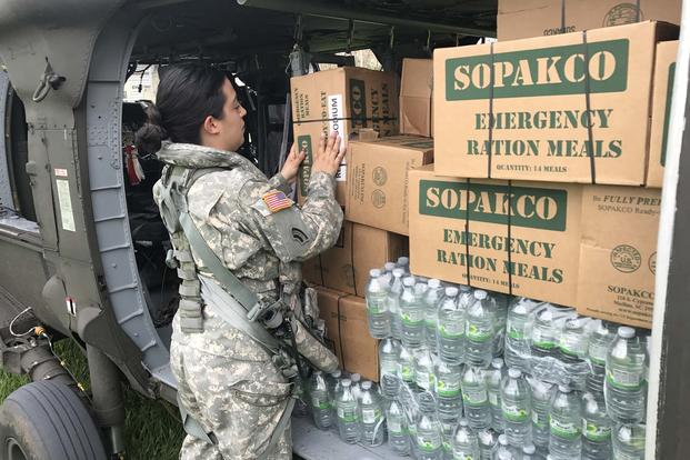 Citizen-Soldiers from Army Aviation of the Puerto Rico National Guard, transported food and water to the municipality of Jayuya, P.R., Sept. 27, 2017. (Photo/ Sgt. José Ahiram Díaz-Ramos/PRNG-PAO)