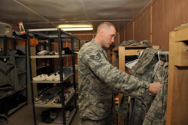 Staff Sgt. Robert Kitchen sorts Airman Battle Uniforms at the 379th Air Expeditionary Wing in Southwest Asia, on Oct. 16, 2013. The Air Force is considering shifting from the ABU to the Army Combat Uniform. Master Sgt. David Miller/Air Force