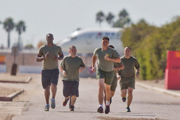 "A group of sailors and Marines who failed the so-called ""tape test'' are led by an instructor on a three mile run as they work to improve their fitness."