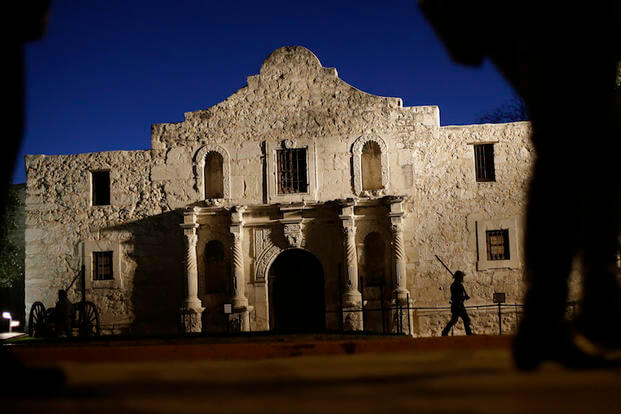 n this March 6, 2013, file photo, Dan Phillips, a member of the San Antonio Living History Association, patrols the Alamo during a pre-dawn memorial ceremony to remember the 1836 Battle of the Alamo.