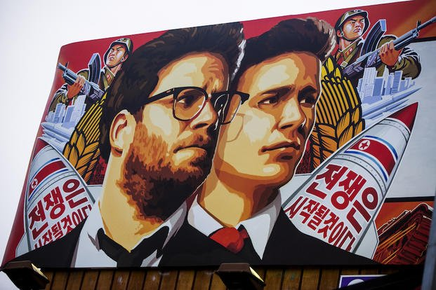 "A banner for ""The Interview""is posted outside Arclight Cinemas, Wednesday, Dec. 17, 2014, in the Hollywood section of Los Angeles."