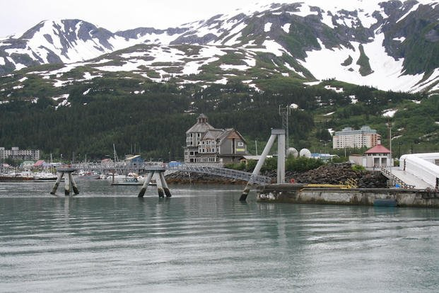 This July 9, 2012 file photo shows the tiny community of Whittier, Alaska, where most of the 180 year-round residents live in the tall condo in the back, a former Army garrison.