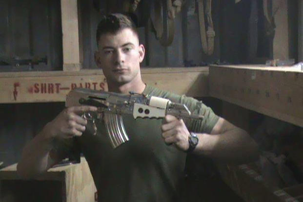 In this 2008 photo provided by Corey Smalley, Eddie Ray Routh poses with an AK-47 at Camp Fallujah in Iraq.