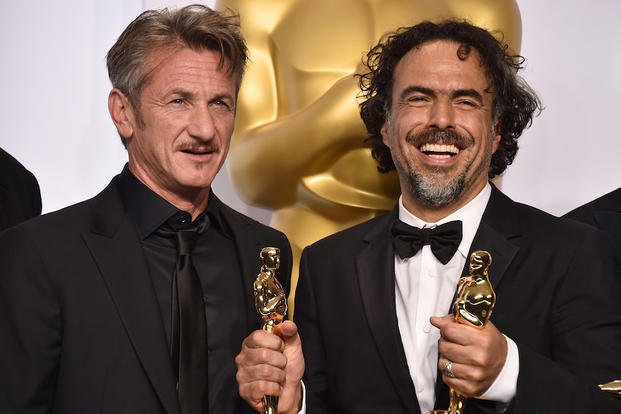 "In this Feb. 22, 2015 file photo, presenter Sean Penn, left, and filmmaker Alejandro Iñárritu pose in the press room after winning multiple awards including best original screenplay, best director and best picture for ""Birdman."""