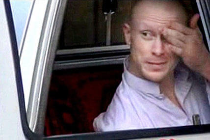 Bowe Bergdahl rubs his head in a still taken from the handover video released by the Taliban.