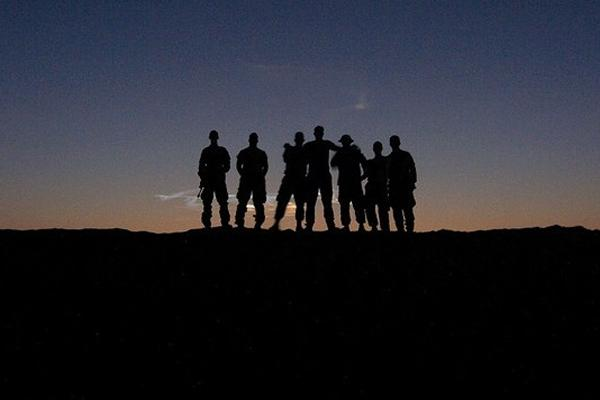 soldiers on hill in sunset
