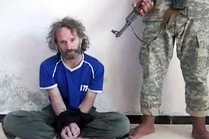 This image made from undated video obtained by The Associated Press, which has been authenticated based on its contents and other AP reporting, shows a man believed to be Peter Theo Curtis, a U.S. citizen held hostage by an al-Qaida linked group in Syria.