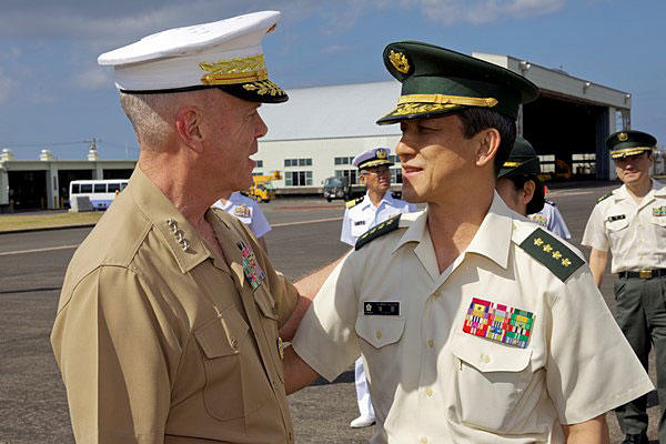 Marine Commandant Gen. James F. Amos greets Gen. Kiyofumi Iwata, Japan Ground Self-Defense Force, at the Iwoto Air Station on the island of Iwo Jima on March 19, 2014. Sgt. Mallory S. VanderSchans/Marine Corps