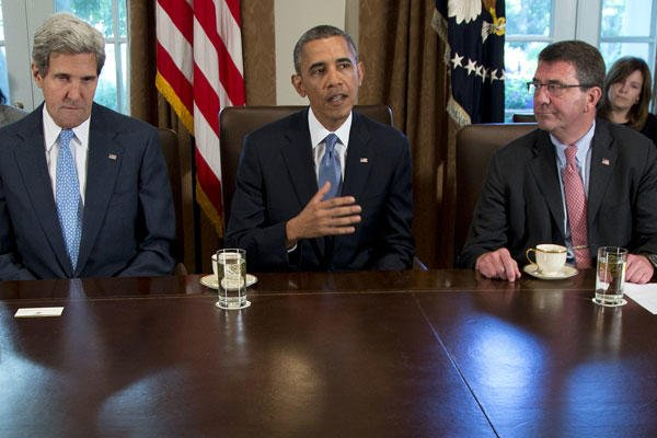 In this Sept. 30, 2013, file photo, then-Deputy Defense Secretary Ashton Carter, right, listens a President Barack Obama speaks to members of the media in the Cabinet Room of the White House in Washington. Carolyn Kaster/AP