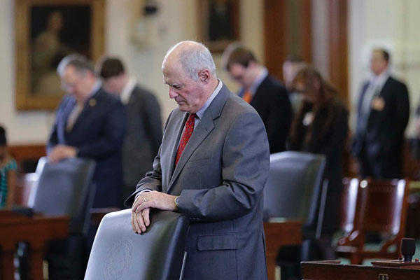 Texas Sen. Kel Seliger, chair of the Senate's higher education committee, stands for the invocation on the floor of the Senate Chamber, Wednesday, March 11, 2015, in Austin, Texas. Eric Gay/AP