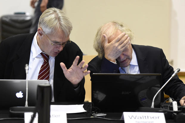 The joint plaintiff's lawyers Cornelius Nestler, left, and Thomas Walther react during the verdict in the case of convicted former SS sergeant Oskar Groening, on July 15, 2015, in Lueneburg, northern Germany. Tobias Schwarz/Pool Photo via AP