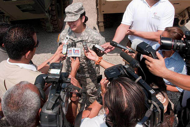 Pvt. Ruth Rios, 560th Battlefield Surveillance Brigade, speaks to the media in El Salvador in 2013. Photo by Tech. Sgt. Mark Wyatt, Joint Task Force Jaguar Public Affairs