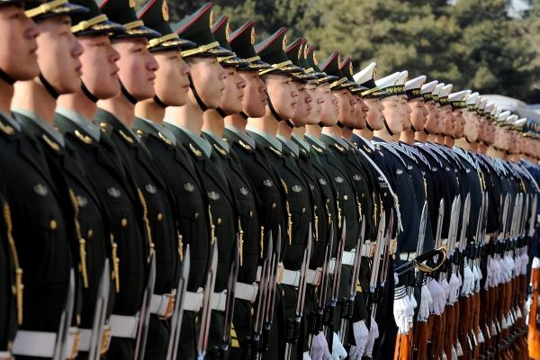 Chinese troops stand at attention during a 2011 ceremony honoring former US Defense Secretary Robert Gates in Beijing. China has created three new army units, but plans to reduce its force of 2.3 million troops by 300,000. (DoD photo)