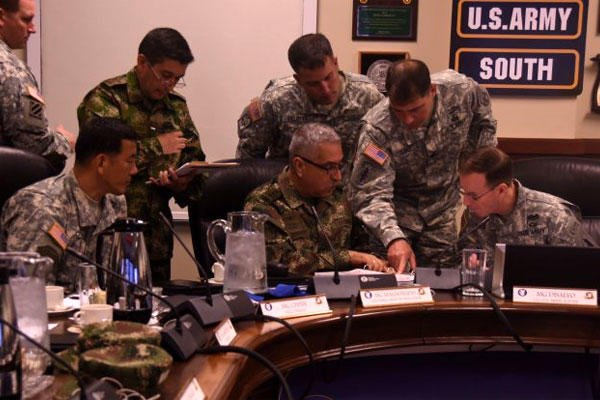 US Army South and Colombian army senior leaders sign an engagement plan during US-Colombia Bilateral Army staff talks in the spring of 2015 at Joint Base San Antonio-Fort Sam Houston. (US Army photo)