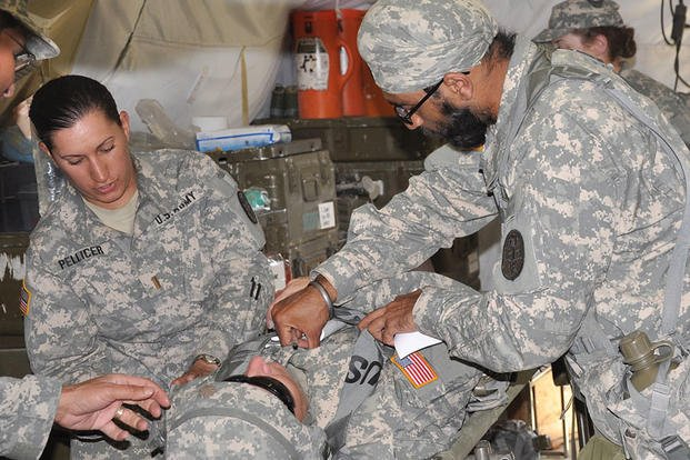 In 2010, Capt. (Dr.) Tejdeep Singh Rattan checks on a patient during an exercise at the Basic officer Course at Camp Bullis. In a feature on Rattan, the Army said his beard and turban didn't interfere with a gas mask and Kevlar helmet. Steve Elliott/Army