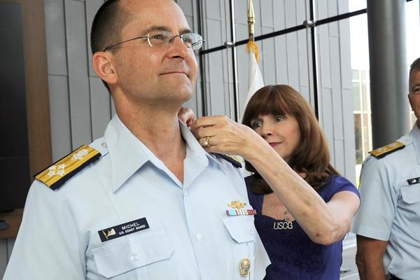 Adm. Charles Michel, vice commandant of the Coast Guard, gets his new shoulderboard for admiral from his wife, Claudia, during a ceremony at the service's headquarters in Washington, D.C., on June 1, 2016. (Photo by Kyle Niemi/U.S. Coast Guard)