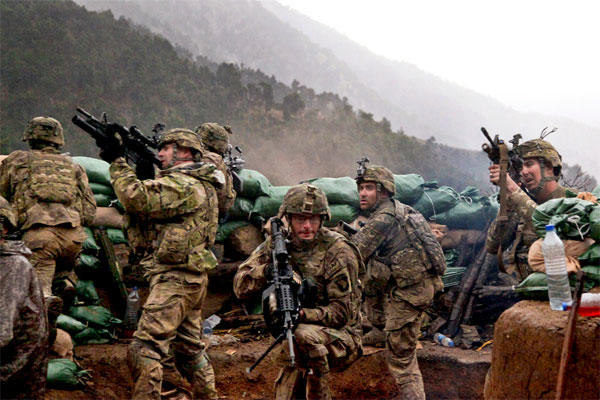 Troops of the 101st Airborne Division return fire during a March 2011 firefight with Taliban forces in Kunar province, Afghanistan. (US Army photo/Cameron Boyd)