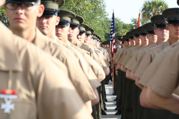 Marines stand at parade rest in this undated photo from the Marine Corps. The service in November 2016 became the last service in the Defense Department to release a policy governing transgender troops.