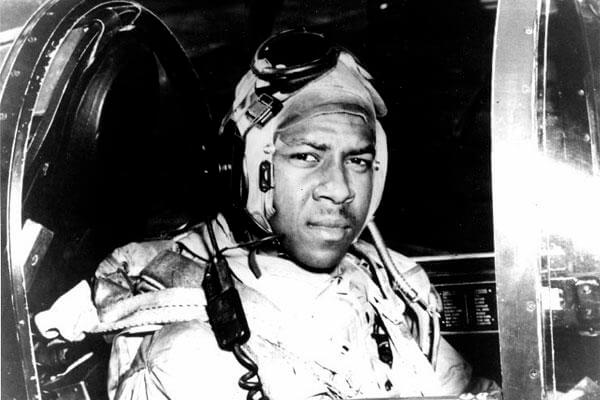 Ensign Jesse L. Brown in the cockpit of an F4U-4 Corsair fighter, circa 1950. A Navy destroyer will carry the name of the man who tried to save him during the Korean War. (US Navy photo)