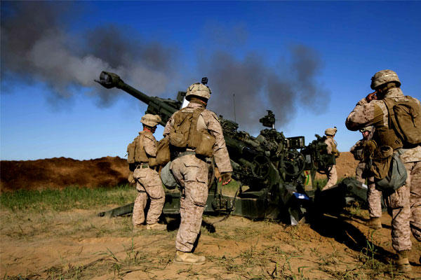 FIRE BASE BELL, Iraq -- U.S. Marines fire an M777A2 Howitzer at an ISIS infiltration route on March 18. (US Marine Corps photo)