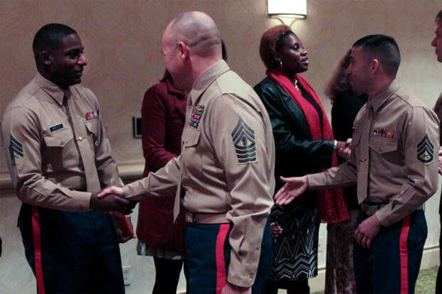 Marines congratulate Sgt. DeMonte R. Cheeley (far left) on receiving the Purple Heart Medal at a Jan. 26, 2016 ceremony, for injuries from a July 2015 attack at the Armed Forces Career Center in Chattanooga, Tenn. (US Marine Corps photo/Diamond Peden)