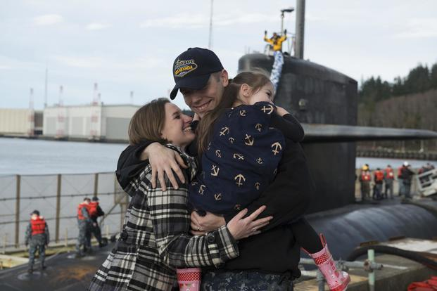 Chief Logistics Specialist Kyle Bryant, assigned to USS Nevada, embraces his family as he returns to Naval Base Kitsap-Bangor on March 21, 2017, following a routine strategic deterrent patrol. Mass Communication Specialist 1st Class Amanda R. Gray/Navy