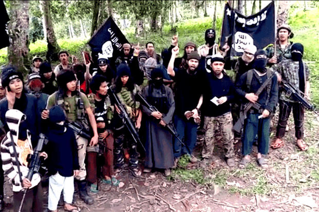 This video screengrab shows several members of Abu Sayyaf, one of several militant groups in the Philippines to have pledged allegiance to ISIS. (Abu Sayyaf)