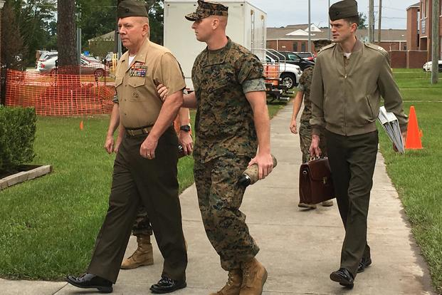Marine Col. Daniel Hunter Wilson is escorted into a court-martial proceeding on Aug. 30, 2017, aboard Camp Lejeune, N.C. Photo by Hope Hodge Seck/Military.com