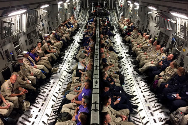 Healthcare professionals travel to Orlando, Fla. on board an Air Force C-17 Globemaster III, in response to a government request to assist with Hurricane Irma disaster response operations. (US Air Force photo/Ryan DeCamp)