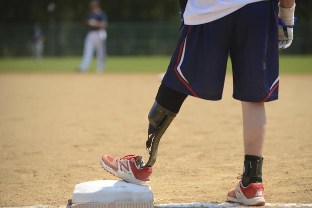 A Wounded Warrior Amputee Softball Team member stands on first base during a game in Newport News, Va., on April 15, 2017. Coapt Engineering is working to adapt its system to power leg prosthetics. Airman 1st Class Kaylee Dubois/Air Force