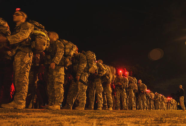 U.S. Army Soldiers conduct a 12-mile foot march during the Ranger Course on Fort Benning, GA., April 23, 2015. Soldiers attend the Ranger Course to learn additional skills in a physically demanding environment. (U.S. Army /Pfc Antonio Lewis/Released)
