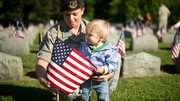 Airman & Son Place Flag on Veteran's Grave