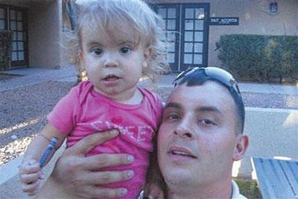 This undated photo provided by U.S. Navy Petty Officer 2nd Class John Moreno shows Moreno and his daughter, Vanessa. Moreno, who lives in New Orleans, has been fighting a custody battle for years over his daughter, who lives in Arizona with her mother.