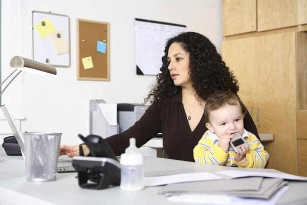 woman working at home with baby