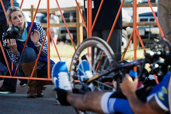 Ashley Means watches for her husband Jeremiah at the finish line of the Warrior Games cycling event Sept. 29, 2014, at Fort Carson, Colo. Senior Airman Jette Carr/Air Force