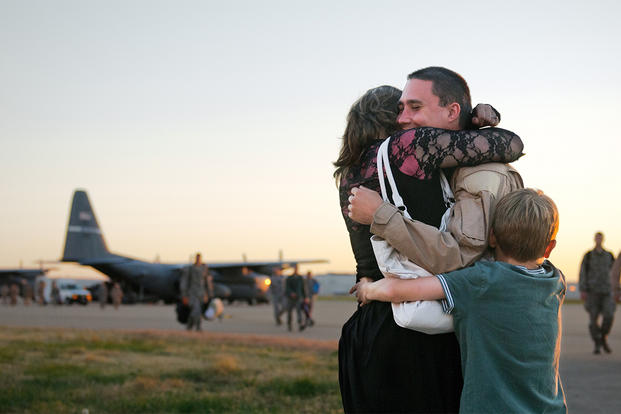 A member of the 123rd Airlift Wing gets a welcome-home hug from loved ones at the Kentucky Air National Guard Base in Louisville, Ky.  (Photo: U.S. Air Force/Master Sgt. Phil Speck)